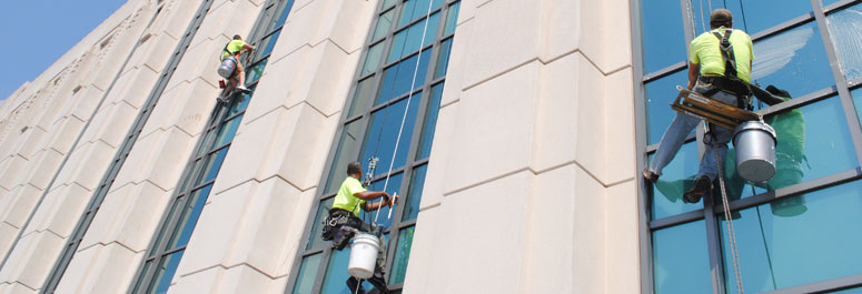 men cleaning high rise building