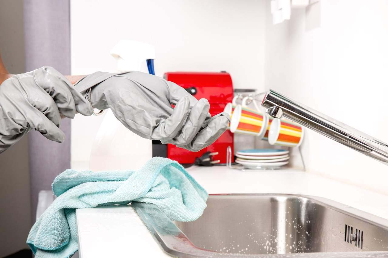 Cleanig services- hands with gloves