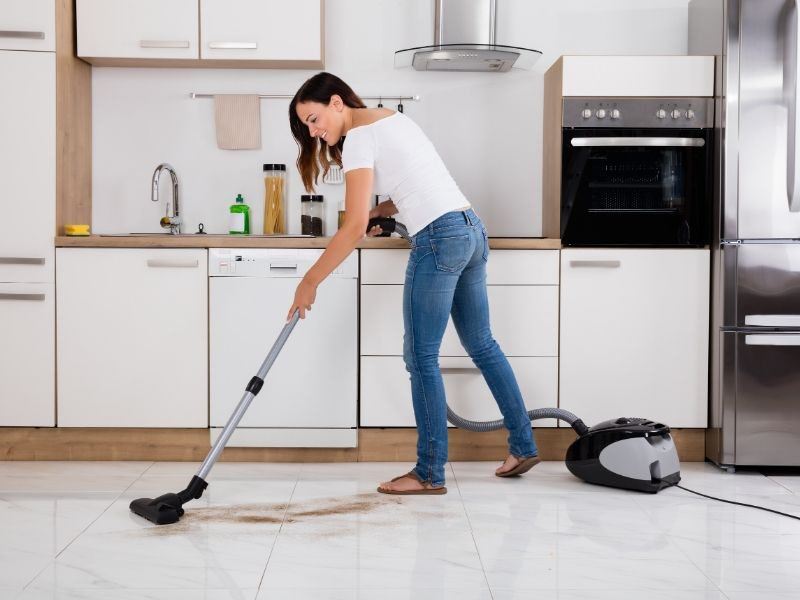 woman vacuuming carpet-standard cleaning